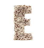 Rice grain forming an alphabet letter E. Different kinds of rice, grain lying and creating an alphabet letter E, different colors royalty free stock image