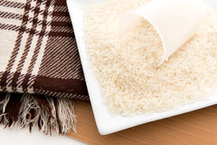 Rice grain (jasmine rice) on table Stock Image