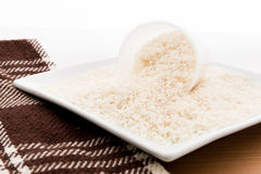 Rice grain (jasmine rice) on table Royalty Free Stock Image