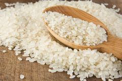 Rice grain in spoon Royalty Free Stock Image