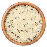 Rice grain uncooked in wooden bowl, isolated Stock Photo