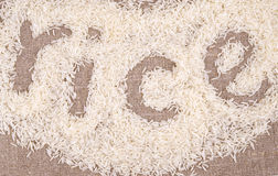 Rice grain white lettering. Figure inscription linen background Royalty Free Stock Photo