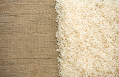 Rice grain on wood. Rice grain and wooden background texture Stock Photo
