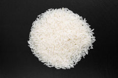 Rice grains on a black background. Hill rice grains on a black background, close-up Stock Photo