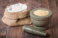 Rice grains in the mortar and flour Royalty Free Stock Images