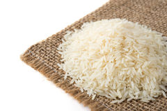 Rice grains on old sack background Stock Photos
