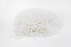 Rice grains on a white background. Hill rice grains on a white background, close-up Royalty Free Stock Photography