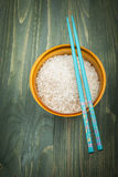 Rice grains in wood bowl Royalty Free Stock Photography