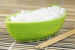 Rice in green clay bowl Royalty Free Stock Photo