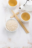 Rice, green tea and chopsticks for sushi Stock Photography