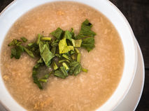 Rice gruel in bowl Stock Photo