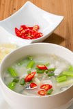 Rice gruel in bowl Stock Photography