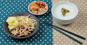 Rice gruel and fried herbs served side dish Stock Image