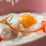 Rice gruel. Traditional chinese porridge rice gruel in bowl Stock Image