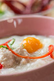 Rice gruel. Traditional chinese porridge rice gruel in bowl Stock Photos