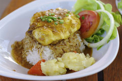Rice with hamburg cheese topping with curry Stock Image