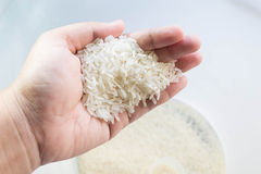Rice in hand Stock Photos