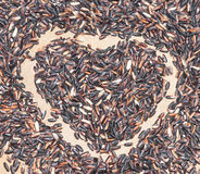 Rice heart. Image of red rice in shape of a heart Stock Photography