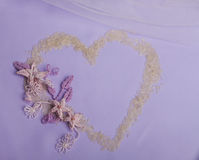 Rice heart and macrame flowers. On violet background for wedding invitations Royalty Free Stock Image