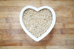 Rice in heart shape bowl Royalty Free Stock Photos