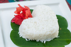 Rice heart shape on white plate Royalty Free Stock Photo