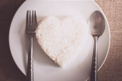 Rice heart shape on whiteplate Royalty Free Stock Photography