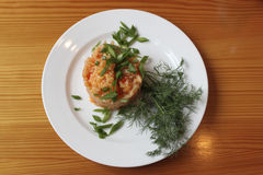 Rice in Hungarian style. With paprika on a white plate with green onions and dill Stock Images