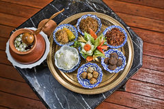 Rice in ice water. With side dishes such deep fried pork, onion, chili. Authentic Thai food Stock Image