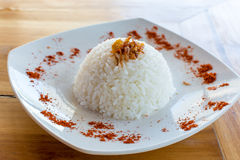 Rice isolated on a white plate. A side of traditional Balinese rice Stock Photo