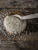 Rice, jasmine rice, mali rice in Ladle and basket on the wood background Royalty Free Stock Photos