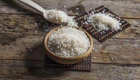 Rice, jasmine rice, mali rice in Ladle and basket on the wood background Royalty Free Stock Photography