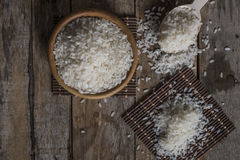 Rice, jasmine rice, mali rice in Ladle and basket on the wood background Royalty Free Stock Images