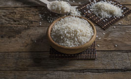 Rice, jasmine rice, mali rice in Ladle and basket on the wood background Stock Images