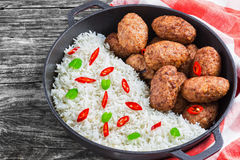 Rice and juicy delicious meat cutlets, view from above Royalty Free Stock Photos