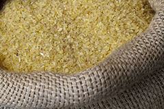 Rice in jute sack. Photographed from top perspective Stock Images