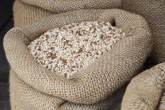Rice in jute sack. Photographed from top perspective Royalty Free Stock Photography