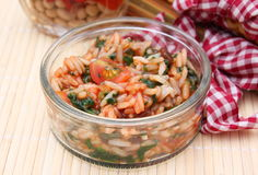 Rice with ketchup. Some rice with ketchup and spinach stock photo