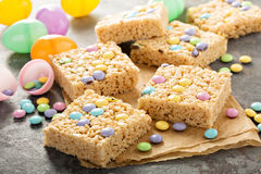 Rice krispies treats with candy. Rice krispies treats with pastel colored candy for Easter royalty free stock image