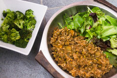 Rice, lentils and salad with broccoli. Rice, beans and salad with broccoli on the side Stock Photo
