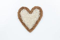 Rice  lies at the heart made of burlap Royalty Free Stock Photos