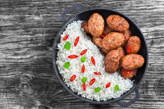 Rice and meat cutlets sprinkled with pieces of chili Stock Image
