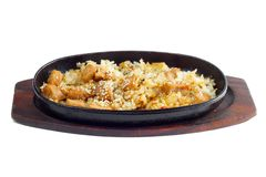 Rice and meat fried in a frying pan Royalty Free Stock Image
