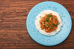 Rice with meat in tomato sause Stock Photo