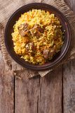 Rice with meat and vegetables on an old table  vertical top view Stock Photos