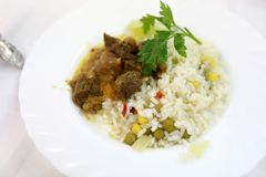 Rice with meat. On white plate in restaurant stock photo