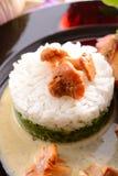 Rice med spenat och kantareller Arkivbild