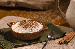 Rice with milk and cinnamon. Rice with milk and cinnamon in clay bowl Stock Photos
