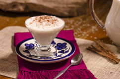 Rice with milk and cinnamon. Rice with milk and cinnamon in glass cup Stock Image