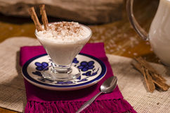 Rice with milk and cinnamon. Rice with milk and cinnamon in glass cup Stock Images