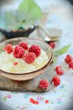 Rice milk porridge with raspberries Stock Photos